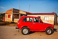Small red car in Gibara, Holguin, Cuba.
