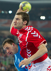 Peter Pucelj of Slovenia vs M. Jurkiewicz of Poland during handball match between National teams of Slovenia and Poland of Qualifications for EURO 2012, on March 9, 2011 in Arena Stozice, Ljubljana, Slovenia. (Photo By Vid Ponikvar  / Sportida.com)