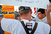 26 SEPTEMBER 2010 - PHOENIX, AZ: A Gay rights demonstrator protesting against Sen. John McCain argues with supporters of Sen McCain in Phoenix Sunday. About 200 people demonstrated and picketed against Arizona Republican Senator John McCain at the studios of KTVK TV in Phoenix, Sunday, Sept 26. They picketed the TV station because McCain was debating his opponents there. They were demonstrating against McCain's positions on the war in Afghanistan, Don't Ask Don't Tell (Gays in the military) and the DREAM Act (for immigrant rights). PHOTO BY JACK KURTZ