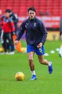AFC Wimbledon defender Will Nightingale (5) warms up prior to the EFL Sky Bet League 1 match between Charlton Athletic and AFC Wimbledon at The Valley, London, England on 15 December 2018.