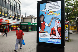 Hounslow, UK. 11th June, 2021. A London Borough of Hounslow Covid-19 public information display urges residents to use surge testing and vaccination facilities amid rising concern regarding the spread of the Delta variant. Hounslow has been identified as a hotspot for the Delta variant first identified in India and both surge testing and increased vaccination have been introduced as counter-measures.