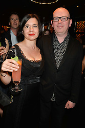 DIANA BEAUMONT and PAUL DONNELLON at a party to celebrate the publication of Behind The Mask by Emma Sayle held at The Playboy Club, 14 Old Park Lane, London on 23rd April 2014.