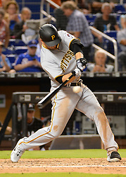 April 18, 2018 - Miami, FL, U.S. - MIAMI, FL - APRIL 13: Pittsburgh Pirates third baseman David Freese (23) hits the ball to the right field for and out  during the the top of the fourth inning of the Major League Baseball game between the Miami Marlins and the Pittsburgh Pirates on April 13, 2018  at Marlins Park in Miami, FL  (Photo by Juan Salas/Icon Sportswire) (Credit Image: © Juan Salas/Icon SMI via ZUMA Press)