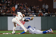San Francisco Giants shortstop Brandon Crawford (35) puts a tag on Los Angeles Dodgers third baseman Chris Taylor (3) during a steal attempt at AT&T Park in San Francisco, California, on April 24, 2017. (Stan Olszewski/Special to S.F. Examiner)