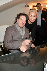 MARCO PIERRE WHITE and TAMARA BECKWITH at a private view to celebrate the 25th anniversary of the publication of White Heat featuring the photographs by Bob Carlos Clarke of Marco Pierre White held at the Little Black Gallery, 13 A Park Walk, London on 10th February 2015.