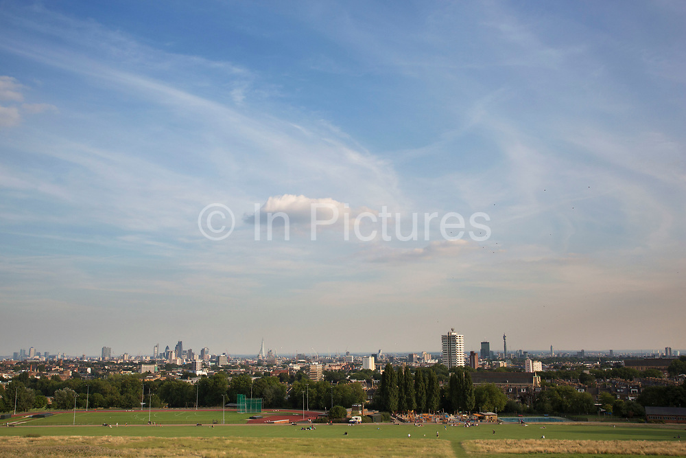 """View of London from Hampstead Heath (locally known as """"the Heath"""") a large, ancient London park, covering 320 hectares (790acres). This grassy public space is one of the highest points in London, running from Hampstead to Highgate. The Heath is rambling and hilly, embracing ponds, recent and ancient woodlands."""