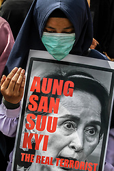 September 6, 2017 - Medan, North Sumatra, Indonesia - Indonesian Muslim women pray while holding Myanmar State Counsellor Aung San Suu Kyi during a demonstration rally against the Rohingya minority persecution in Medan on September 6, 2017, Indonesia. Indonesian Muslims held angry demonstrations against the persecution and condemned the worsening humanitarian situation in Rakhine state, also called on the Indonesian government to take a tougher stance against it for an end to violence against the Rohingya Muslim minority in the country. (Credit Image: © Ivan Damanik via ZUMA Wire)