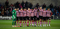 Lincoln City during a minutes silence as a mark of respect to Grace Millane, a former University of Lincoln pupil<br /> <br /> Photographer Chris Vaughan/CameraSport<br /> <br /> The EFL Sky Bet League Two - Saturday 15th December 2018 - Lincoln City v Morecambe - Sincil Bank - Lincoln<br /> <br /> World Copyright © 2018 CameraSport. All rights reserved. 43 Linden Ave. Countesthorpe. Leicester. England. LE8 5PG - Tel: +44 (0) 116 277 4147 - admin@camerasport.com - www.camerasport.com