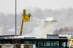 © Licensed to London News Pictures. 08/02/2021. Leeds UK. Ice & snow are removed from an aircraft before take off at Leeds Bradford airport in Yorkshire this todayas the UK is battered by Storm Darcy. Photo credit: Andrew McCaren/LNP