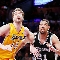 19 March 2014: Los Angeles Lakers center Pau Gasol (16) vies for the rebound with San Antonio Spurs forward Tim Duncan (21) during the San Antonio Spurs 125-109 victory over the Los Angeles Lakers at the Staples Center, Los Angeles, California, USA.