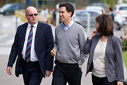 © Licensed to London News Pictures. 29/09/2012. Manchester, UK . Left to right: School Principle Guy Hutchence , Ed Miliband & Labour Candidate Lucy Powell arrive at the venue. Ed Miliband holds an open Q&A session with members of the public at The East Manchester Academy , ahead of the Labour Party Conference . Photo credit : Joel Goodman/LNP