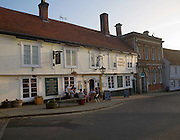 People sitting outside the Crown Hotel, Framlingham, Suffolk, England