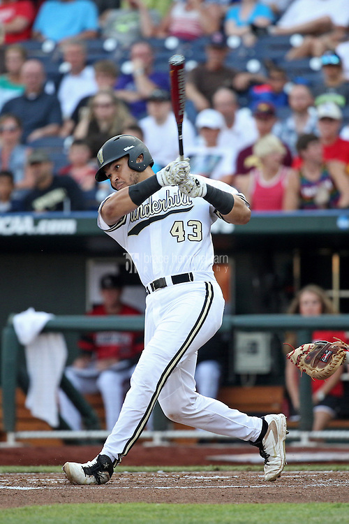 Zander Wiel #43 of the Vanderbilt Commodores bats during Game 2 of the 2014 Men's College World Series between the Vanderbilt Commodores and Louisville Cardinals at TD Ameritrade Park on June 14, 2014 in Omaha, Nebraska. (Brace Hemmelgarn)