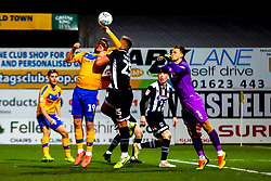 The ball connects with the hand of Andy Cook of Mansfield Town - Mandatory by-line: Ryan Crockett/JMP - 04/01/2020 - FOOTBALL - One Call Stadium - Mansfield, England - Mansfield Town v Grimsby Town - Sky Bet League Two