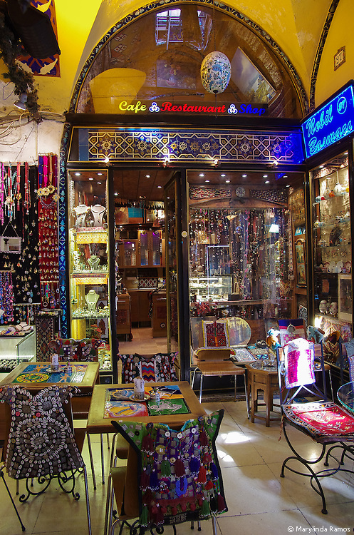 A cafe with hand-crafted vests decoraing its chairs in the Grand Bazaar