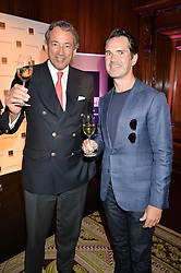 """Left to right, BRUNO PAILLARD and JIMMY CARR at the presentation of Le Prix Champagne De La Joie de Vivre to Stephen Webster in celebration of his long standing contribution to """"Joie de Vivre' held at the Council Room, One Great George Street, London on 22nd April 2015."""
