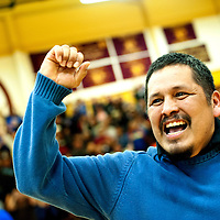 022813  Adron Gardner/Independent<br /> <br /> Navajo Pine Warrior boys basketball coach Doranci Poyer punches the air after the Warriors beat theTohatchi Cougars in the District 1-2A semifinals in Tohatchi Thursday.