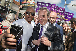 © Licensed to London News Pictures. 20/06/2016. Clacton-on-Sea, UK . UKIP party leader Nigel Farage poses for a photograph as he meets with supporters during campaigning for Brexit in the last few days of the EU referendum. Photo credit: Peter Macdiarmid/LNP