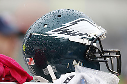 Drops of rain are seen on a  Philadelphia Eagles helmet in the bench area during the NFL game between the Atlanta Falcons and the Philadelphia Eagles on Sunday, October 28th 2012 in Philadelphia. The Falcons won 30-17. (Photo by Brian Garfinkel)