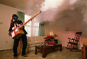 A deodorizing company spreads aromatic fog to rid an apartment of the odor of smoke.