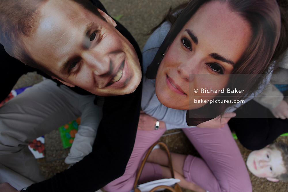 Monarchists in William and Kate masks celebrate their Queen's Diamond Jubilee weeks before the Olympics come to London. The UK  enjoys a weekend and summer of patriotic fervour as their monarch celebrates 60 years on the throne. Across Britain, flags and Union Jack bunting adorn towns and villages.