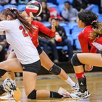 St. Michaels Cardinal Sierra Badonie (6) and her teammates try to get under a shot from the Piñon Eagles Tuesday at Window Rock High School.