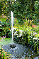 stone water fountain in a country garden