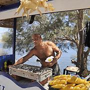 Man grills and sells corn on Santorini island
