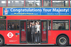 "© licensed to London News Pictures. London, UK 10/05/2012. Muslim supporters of Diamond Jubilee posing with on a bus with has a banner reading ""Congratulations Your Majesty!"" outside Tower of London, today (10/05/12). Ahmadiyya Muslim Association and various charities launching a campaign to celebrate the Queen's Diamond Jubilee. The campaign will have 100 London buses with banners reading ""Congratulations Your Majesty!"" and a charity walk on this Sunday. Photo credit: Tolga Akmen/LNP"