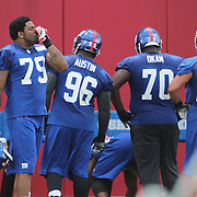 Damontre Moore (left, 79), takes a moment to use an inhaler during the 2013 New York Giants Training Camp at the Quest Diagnostics Training Centre, East Rutherford, New Jersey, USA. 29th July 2013. Photo Tim Clayton.