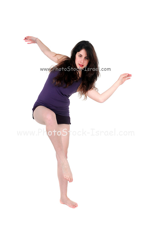 Studio shot of a young woman losing balance On white Background