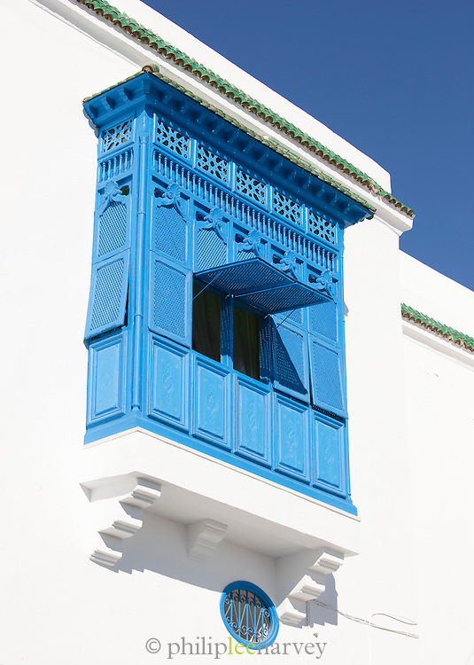 Blue shutters open on balcony, Sidi Bou Said, Tunisia