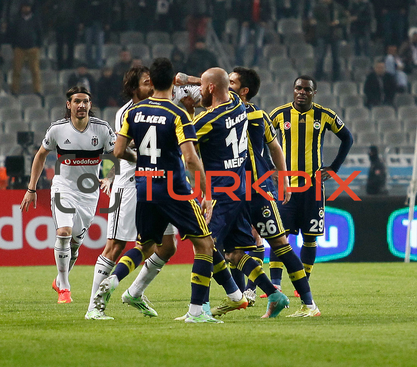 Besiktas's Veli Kavlak (2ndL) and Fenerbahce's Raul Jose Trindade Meireles (C) during their Turkish superleague soccer match Besiktas between Fenerbahce at Ataturk Olimpiyat Stadium in Istanbul Turkey on Sunday 02 November 2014. Photo by Aykut AKICI/TURKPIX