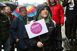 © Licensed to London News Pictures. 02/07/2016. Leeds, UK. A supporter holds a pro-Corbyn sign as she listens to speakers at the demonstration. Hundreds of people braved the rain in Leeds city centre, West Yorkshire, to support Labour leader Jeremy Corbyn. Corbyn, who was only elected nine months ago with an overwhelming majority, faced a vote of no confidence this week from his MPs. It is now likely that the Labour Party will see another leadership election. Photo credit : Ian Hinchliffe/LNP