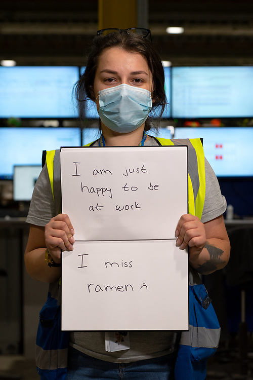 Lucia Spisiakova is pictured Inside Amazon Fulfillment Center Man 3 Near Bolton.  She has worked at Amazon for 2 1/2 years, She is from Slovakia, Essex, Manchester. She was asked to write two ways she felt the COVID 19 Lockdown had impacted herself.