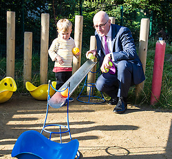 Pictured: John Swinney was joined by two year old Archie for some fun in the sunshine<br /> <br /> Education Secretary John Swinney MSP met staff and children at Davidson's Mains Primary School nursery today as he reaffirmed his commitment to the transformation of early learning and childcare. <br /> <br /> Ger Harley: 6 September 2018