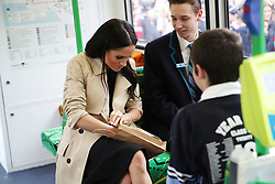 Duchess of Sussex talks to students from Albert Park Primary School, Port Melbourne Primary School and Elwood Secondary College while riding on a tram in Melbourne, on the third day of the royal couple's visit to Australia.