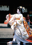 A geisha performs a traditional dance at the Meiji Shrine in Tokyo, Japan.