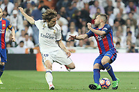 Luka Modric of Real Madrid competes for the ball with Jordi Alba of FC Barcelona during the match of La Liga between Real Madrid and Futbol Club Barcelona at Santiago Bernabeu Stadium  in Madrid, Spain. April 23, 2017. (ALTERPHOTOS)