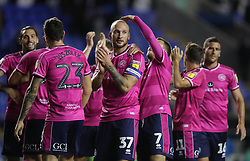 Queens Park Rangers's Toni Leistner (centre) is congratulated by his team mates after the Sky Bet Championship match between Reading and Queens Park Rangers.