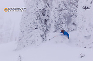 Skiing powder on Evan's Heaven at Whitefish Mountain Resort in Whitefsh, Montana, USA model released
