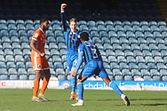 GOAL Kgosi Nthle begins to celebrate 1-0 during the EFL Sky Bet League 1 match between Rochdale and Shrewsbury Town at Spotland, Rochdale, England on 9 March 2019.