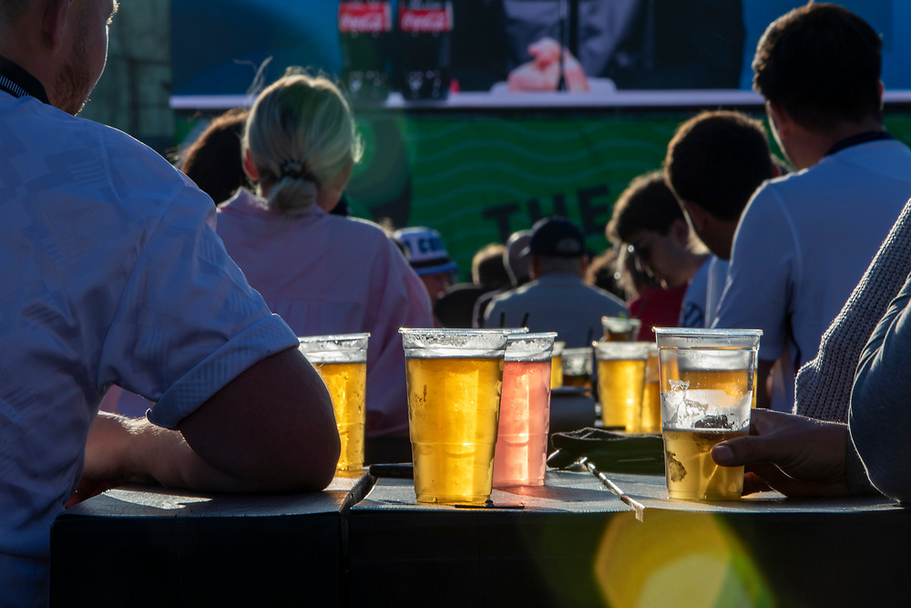 People enjoying a few drinks during the Euro 2020 semi final match between England and Denmark on the 7th of July 2021 at the outdoor screen at Folkestone Harbour Arm, in Folkestone, United Kingdom. (photo by Andrew Aitchison / In pictures via Getty Images)
