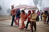 Kids walk to school together on a foggy morning, Sapa, Lao Cai Province, Vietnam, Southeast Asia