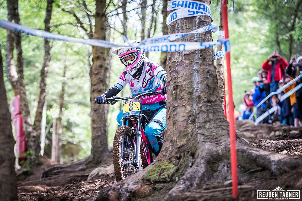 Tracey Hannah cuts through the woods on her way to win the women's UCI Mountain Bike World Cup in Fort William.
