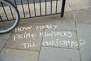 Chalk graffiti on the pavement outside  the Houses of Parliament asking  How Many Prime Ministers Till Christmas on 9th September 2019 in London, United Kingdom. Prime Minister Boris Johnson is tabling another motion to seek a general election.