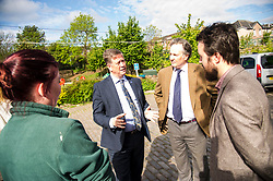Pictured: Maia Gordon, Keith Brown,  George Elliis and Josiah Lockhart<br /> <br /> Cabinet Secretary for Economy, Jobs & Fair Work Keith Brown visited Gorgie City Farm today  to mark their accreditation as the 800th Living Wage employer in Scotland. Mr Brown met Josiah Lockhart, CEO and undertook a short tour of the farm, celebrating their accreditation and promoting the Living Wage more generally. The Scottish Government has set a target of reaching 1,000 Scottish-based Living Wage Accredited Employers by autumn 2017. While at the farm Mr Brown met Maia Gordon, Kirsty McGoff (17) and Zoe White (18), who have benefited from the living wage, and George Ellis, chair of the farm's board of directors<br /> Ger Harley   EEm 18 May 2017