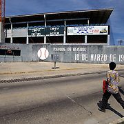 MINATITLAN, MEXICO: A fan makes his way to the baseball stadium in Minatitlan, Mexico for a afternoon game.