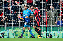 Callum Wilson of Bournemouth has trouble getting the ball from Hector Bellerin of Arsenal after scoring. - Mandatory by-line: Alex James/JMP - 14/01/2018 - FOOTBALL - Vitality Stadium - Bournemouth, England - Bournemouth v Arsenal - Premier League