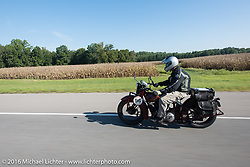Doug Jones riding his 1929 Indian 101 Scout during Stage 5 of the Motorcycle Cannonball Cross-Country Endurance Run, which on this day ran from Clarksville, TN to Cape Girardeau, MO., USA. Tuesday, September 9, 2014.  Photography ©2014 Michael Lichter.